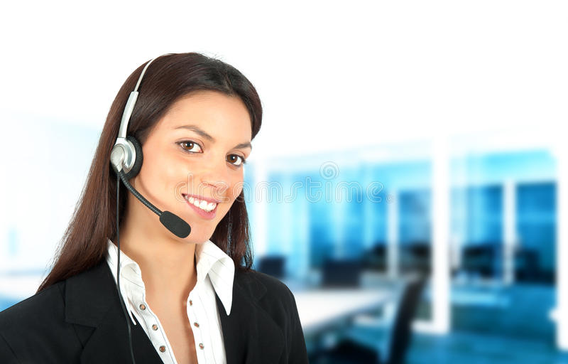 Call center support. Smiling girl works in a call center