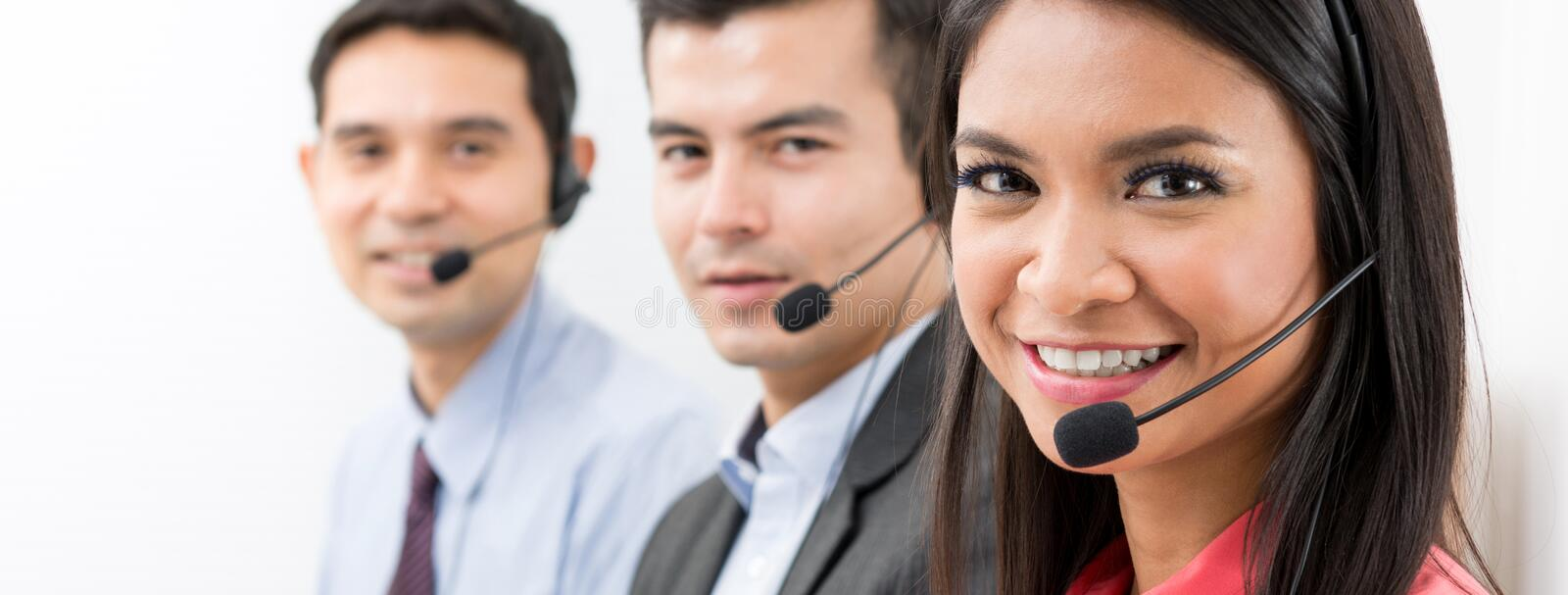Call center telemarketing or customer service team. Panoramic banner stock photography