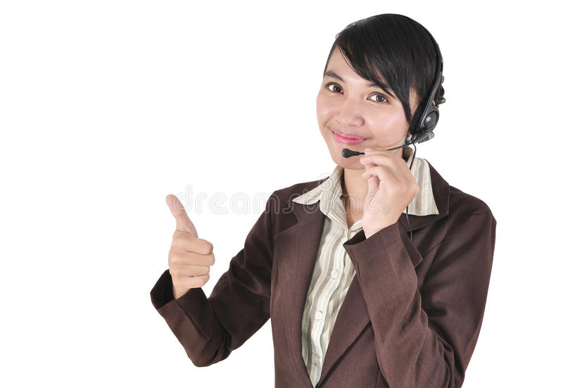 Call center woman with headset showing thumb up stock photography