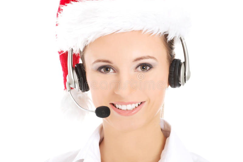 Call center woman with red Christmas hat stock photo
