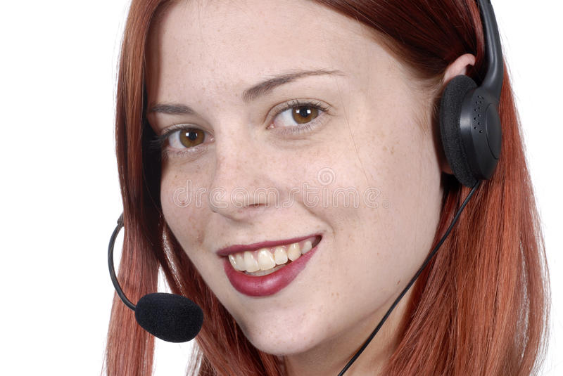 Close up of young adult female call center woman, telephone headset, smiling, white background stock photo