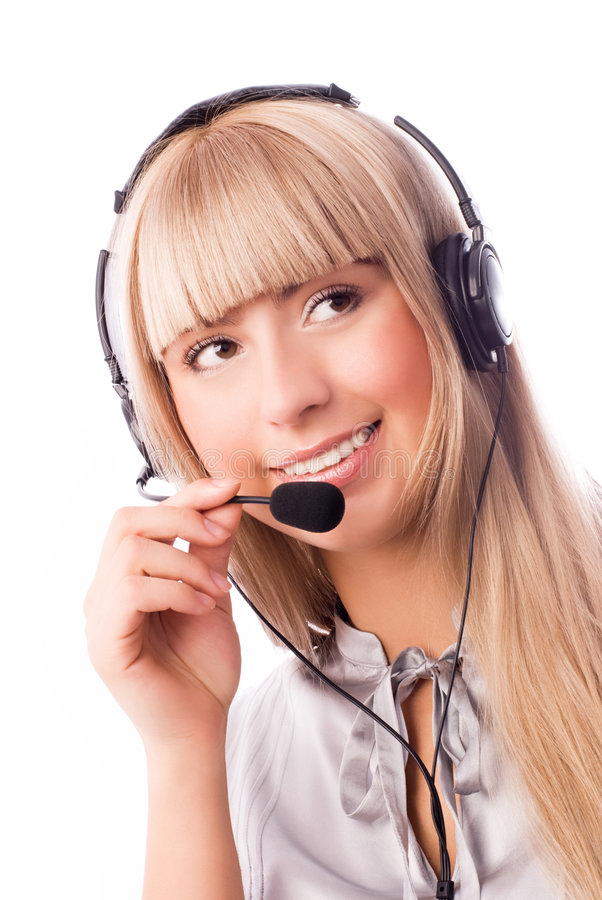 Call-center worker. Beautiful young blond woman wearing earphones with a microphone stock images
