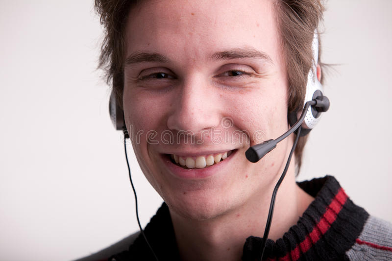 Call center young man with a headset royalty free stock images