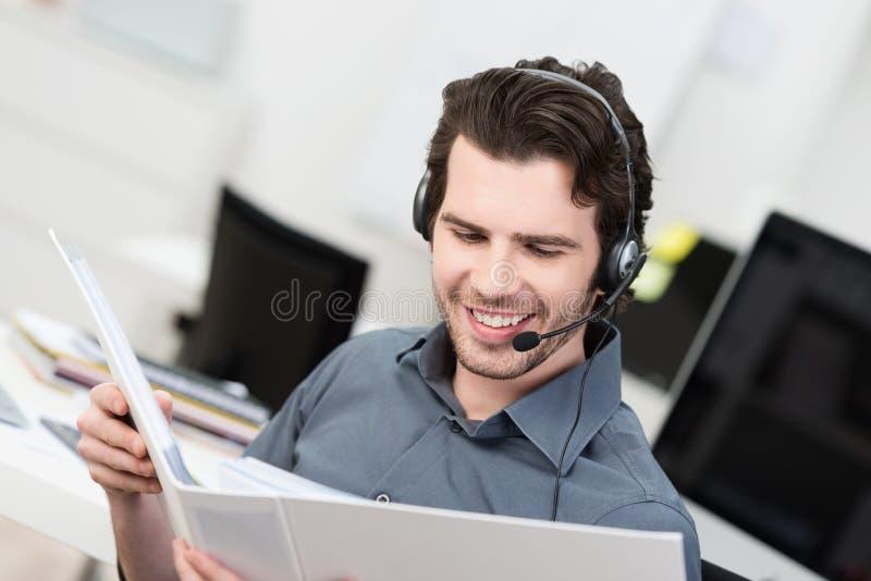 Call centeroperatörs- eller klientservice fotografering för bildbyråer