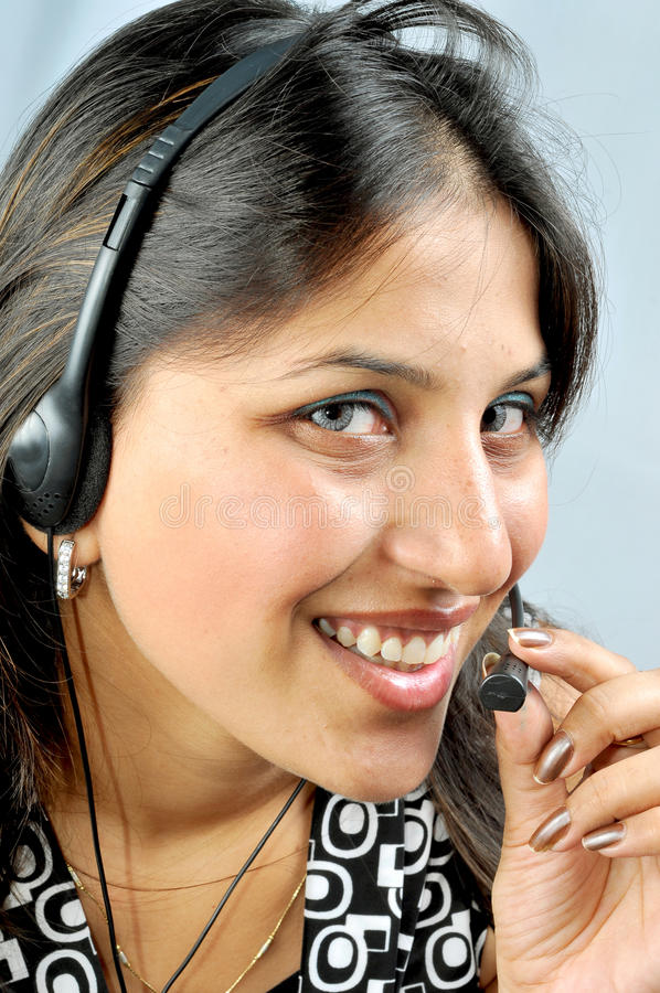 Call centre executive. Talking to her costumer stock image