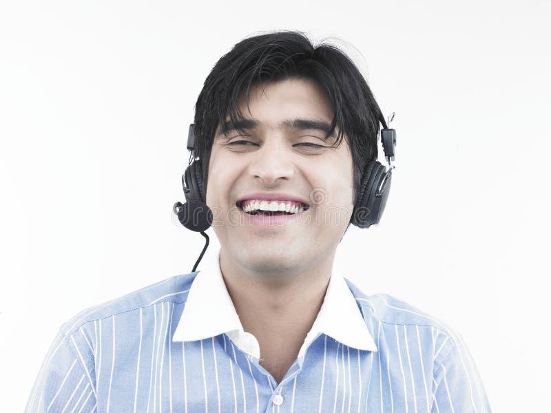 call centre executive laughing στοκ φωτογραφία