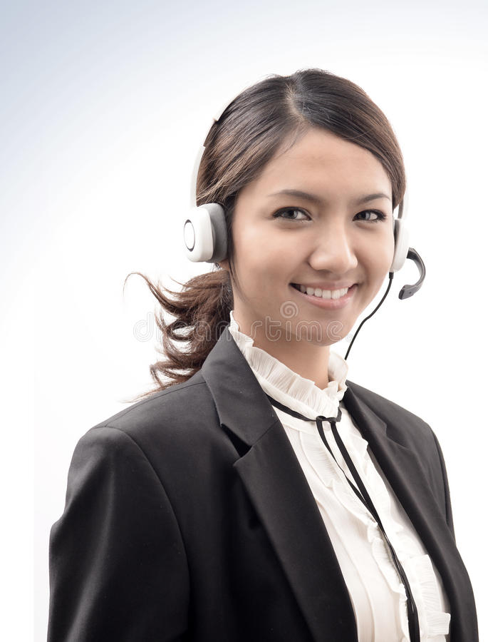 Call centre operator asian girl royalty free stock photography