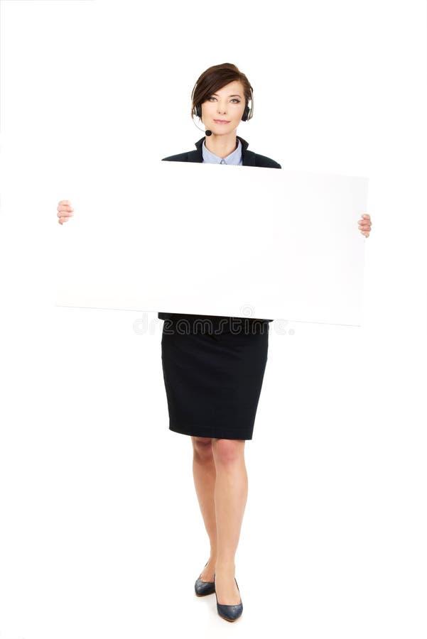 Call centrevrouw die lege banner houden stock foto's
