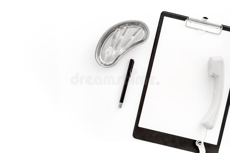 Call doctor. Phone, clip pad and cuvette with ampoulie on white background top view mockup copyspace. Call doctor. Phone, clip pad and cuvette with ampoulie on stock photography