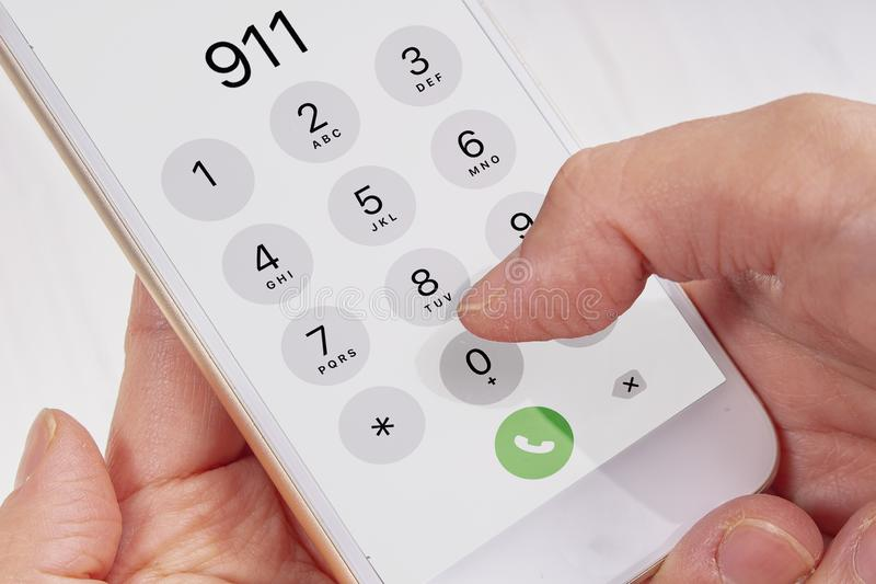 Call emergency 911 hands holding a phone royalty free stock photos