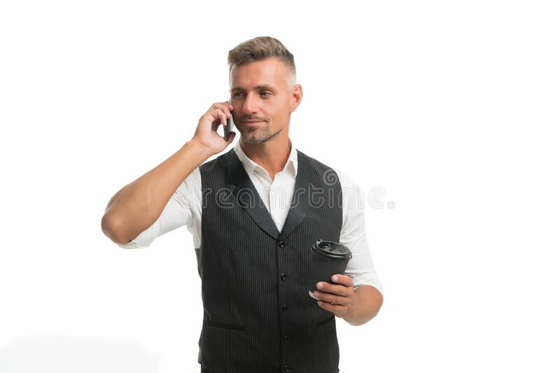 Call friend. Leisure. Time for recharge. Mobile communication. Coffee take away. Mature man hold paper coffee cup white. Background. Delicious fresh coffee royalty free stock photos
