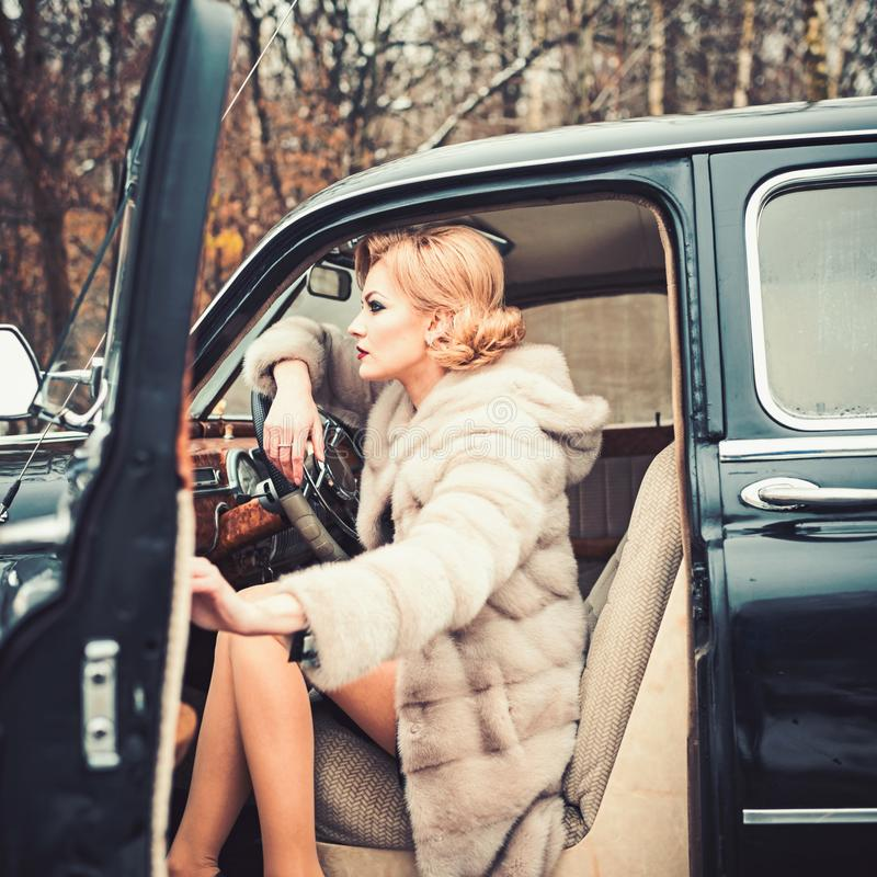 Call girl in vintage car. Travel and business trip or hitch hiking. Escort and security guard for luxury woman. sexy stock photos
