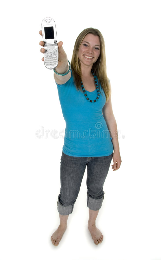 Call me. Teenage girl holding cell phone royalty free stock images