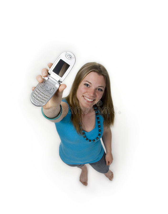 Call me. Diminishing perspective of teenage girl with cell phone royalty free stock images