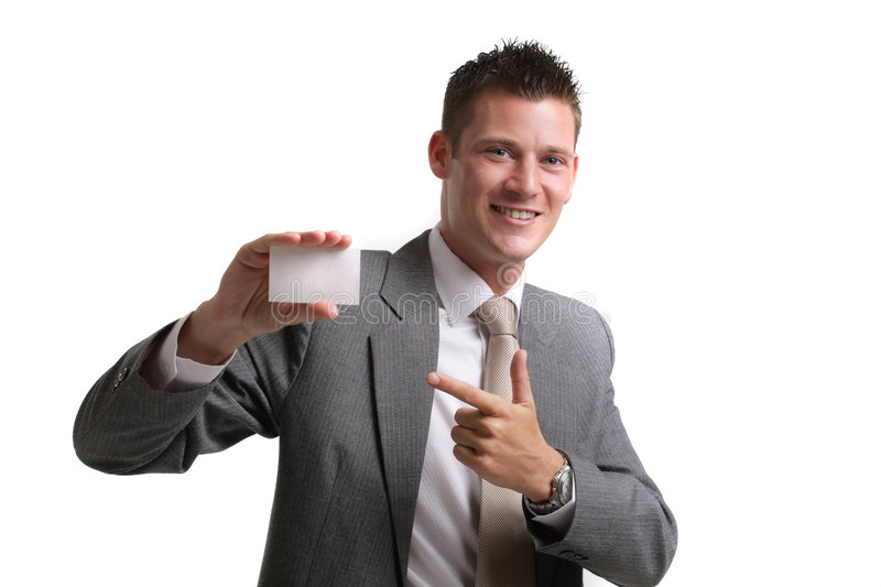 Call me!. Young cheerful executive presenting a blank business card stock image
