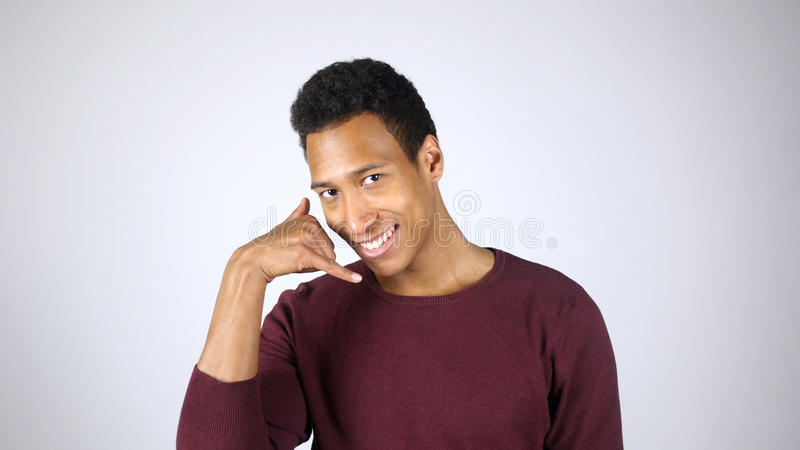 Call me for Help, Contact Us Gesture by Afro-American Man stock photography