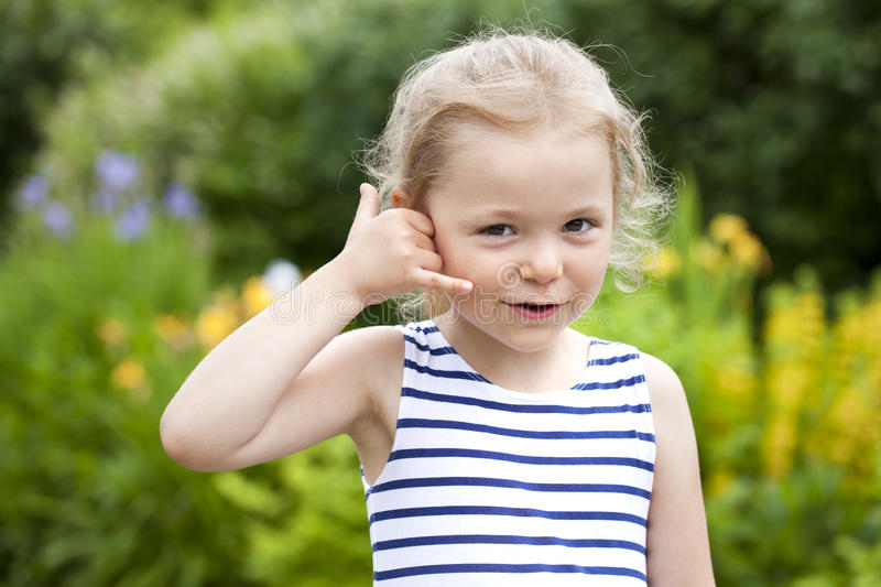 Call Me, Little Girl making a call me gesture stock photography