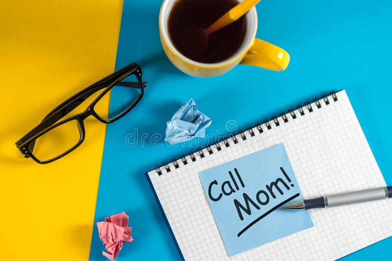 Call Mom - A message asking or reminding you to call your mom. Parenting Concept.  stock photography