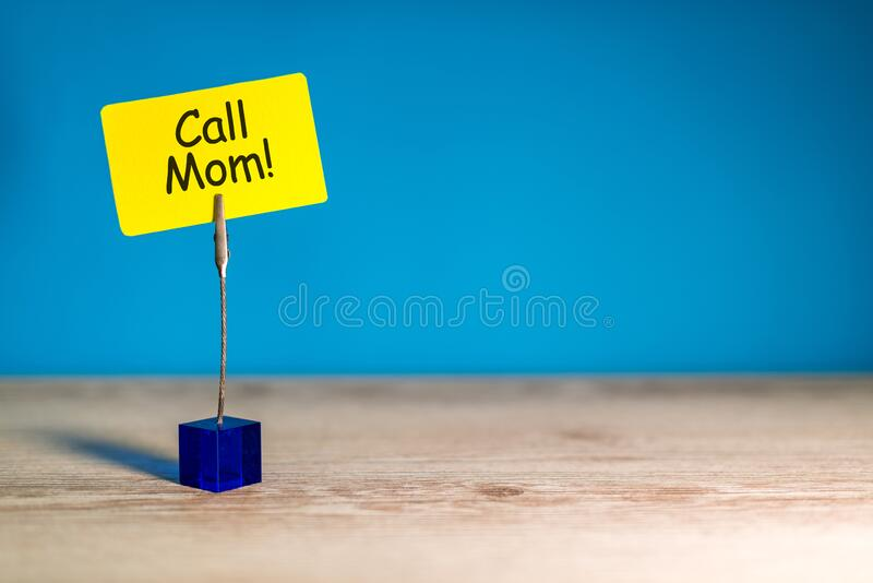 Call Mom - A message asking or reminding you to call your mom. Parenting Concept.  royalty free stock photography