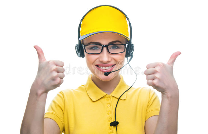 Call service operator. Smiling girl on helpline operator gesturing thumbs up in call center, isolated on white background.Close-up of woman in a call service or royalty free stock photos