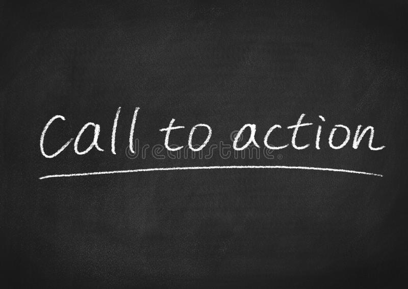 Call to action. Concept words on a blackboard background stock image