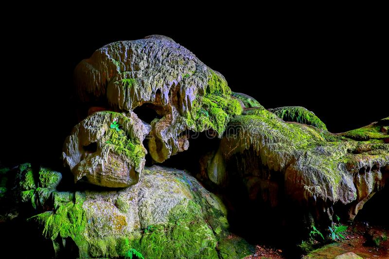 Callao cave stalactites, cagayan, philippines. Natural formation of stalactites and stalagmites inside the callao cave covered in green moss at tuguegarao royalty free stock images