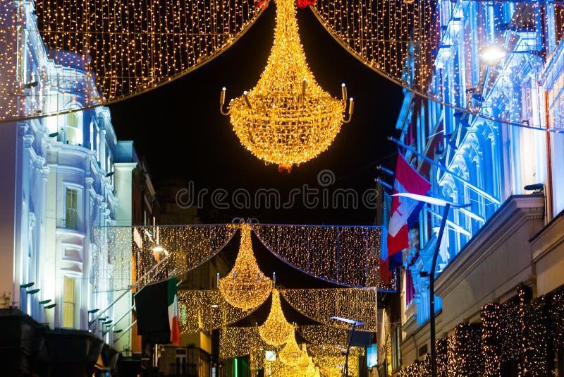 Calle de Grafton en Dublín, luz de la Navidad El ` de Nollaig Shona Duit del ` de la inscripción es ` de la feliz Navidad del ` e imagen de archivo