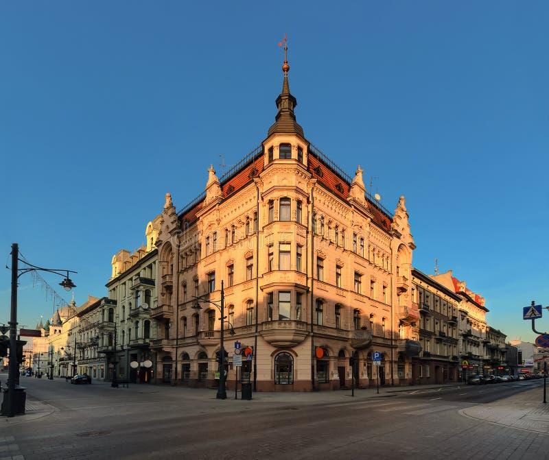 Calle de Piotrkowska en Lodz, Polonia en la tarde fotografía de archivo libre de regalías