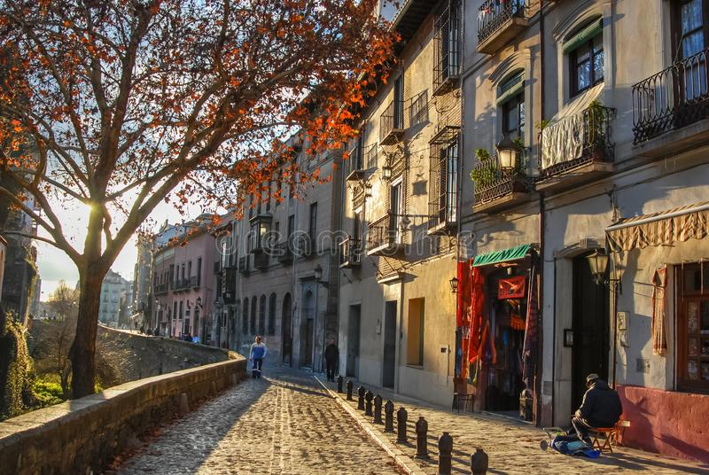 Calle del darro in Granada,Andalucia,Spain. A peaceful winter scene and great for walking along Paseo de Padre Manoin,Granada,Andalucia,Spain stock images