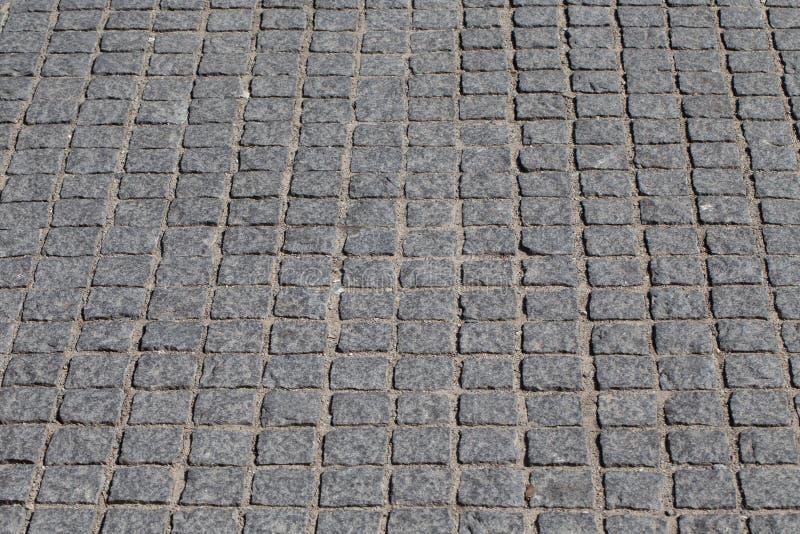 Calle pavimentada piedra vieja de la avenida foto de archivo libre de regalías