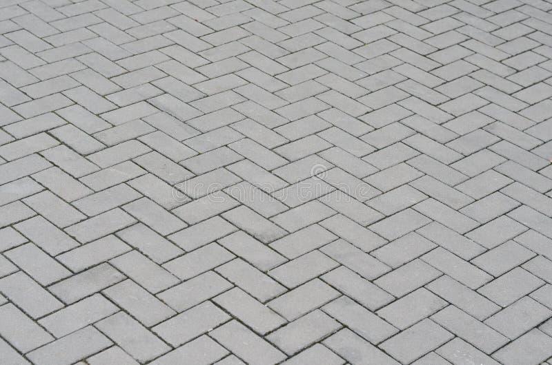 Calle vieja de la textura del fondo del extracto del pavimento del guijarro imágenes de archivo libres de regalías