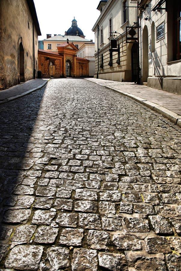 Calle vieja en Kraków, Polonia. fotografía de archivo libre de regalías