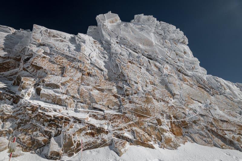 "So called ""frozen wall"" in front of a blue sky in Austrian ski region of Hintertux Glacier. Zillertal, Austria stock photo"