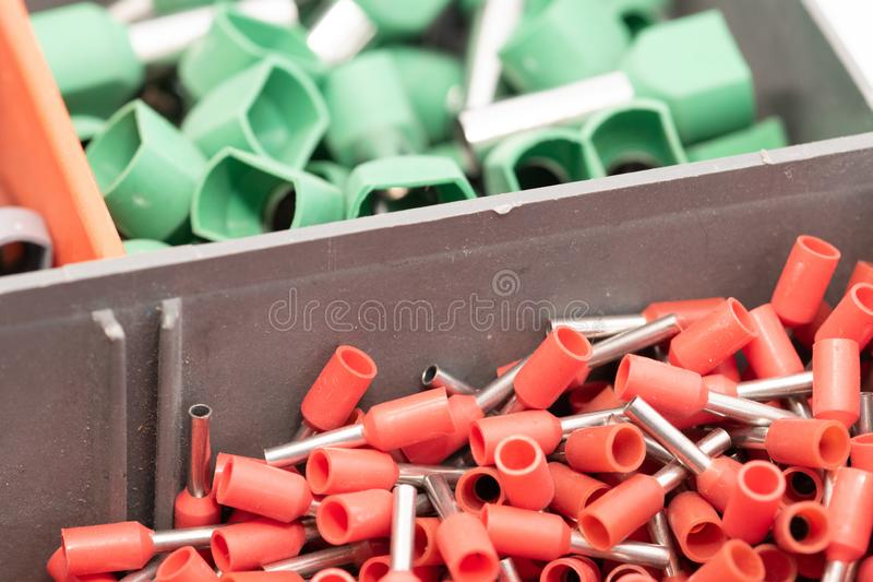 Terminals for electric conductors in d ifferent sizes. So-called hollow-tip terminals for electric conductors in different color codes and sizes royalty free stock images