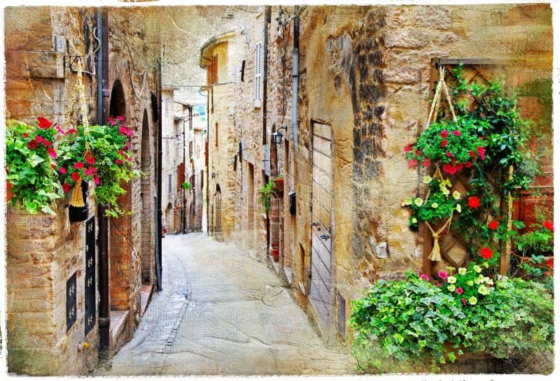 Calles encantadoras de las ciudades medievales, Spello, Italia imagenes de archivo