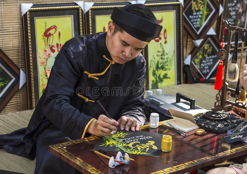 Calligrapher write couplets New Year greetings stock photos