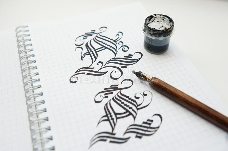 Download Calligraphic Drawings Words And Pen For Calligraphy Stock Photo