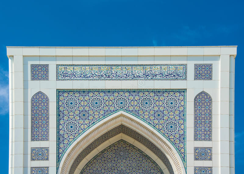 Calligraphic patterns Minor mosque in Tashkent, Uzbekistan. Beautiful white calligraphic patterns Minor mosque in Tashkent, Uzbekistan royalty free stock photography