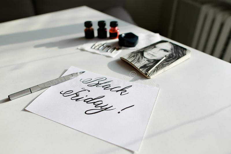Calligraphic text Black Friday, written by brushpen in black pai stock photo