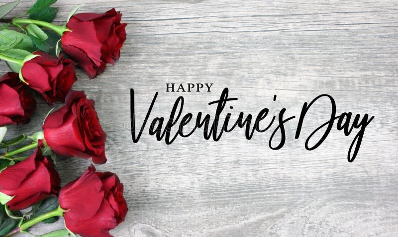 Calligraphie heureuse de Saint-Valentin avec les roses rouges illustration stock