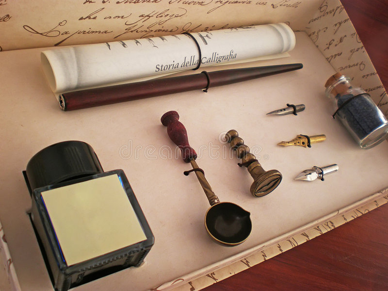 Calligraphy ink pen set. In a box on wooden table royalty free stock images