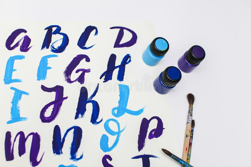 Calligraphy lettering alphabet drawn with dry brush. Letters of English ABC written with paint brush. Concept hobby or education royalty free stock images
