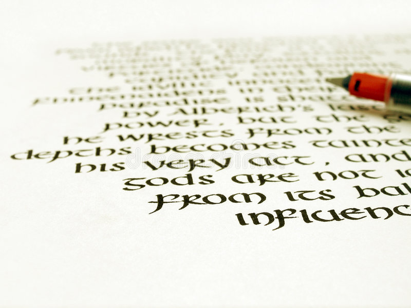 Calligraphy pen and writing on white paper stock photos
