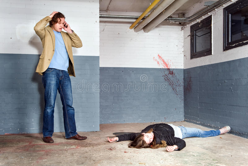 Calling 911. Bystander, discovering a murdered woman in a basement, and calling 911 stock image