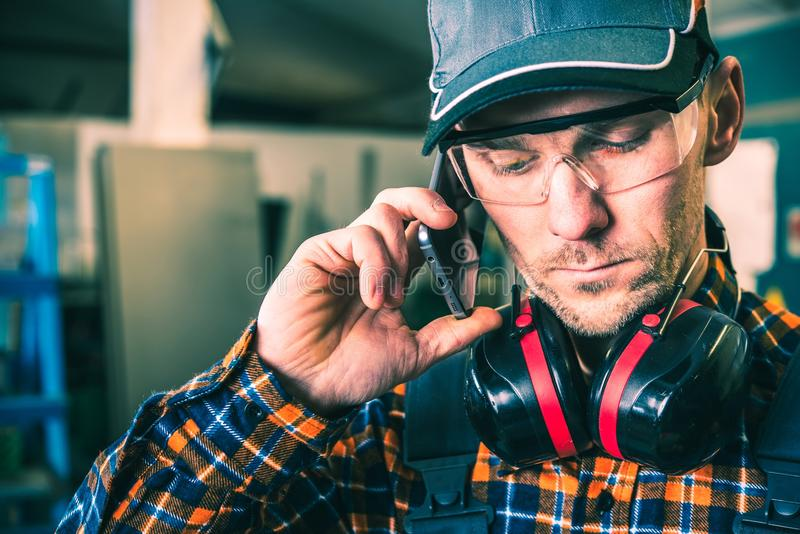 Calling For Advice. Factory Technician Calling For Advice. Production Worker Making a Call royalty free stock image