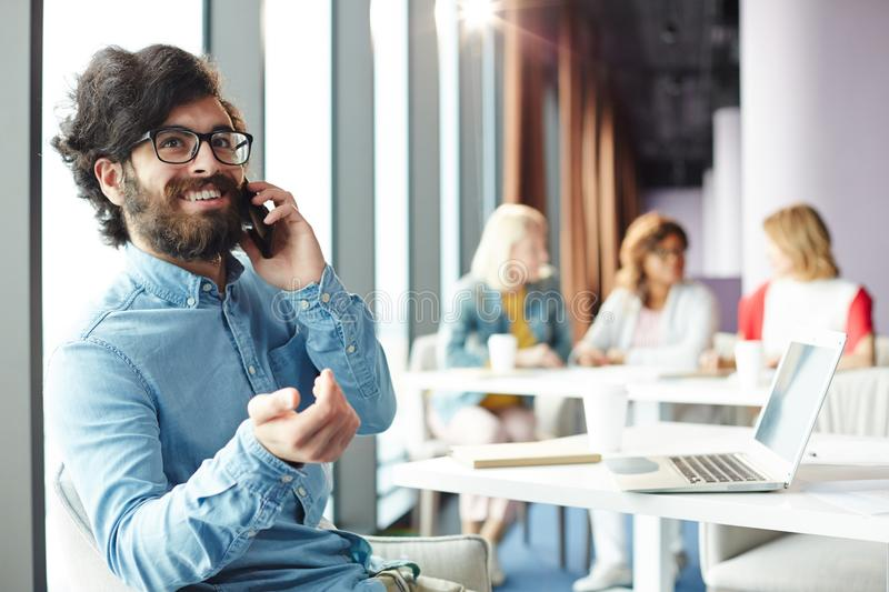 Calling client in office royalty free stock photography