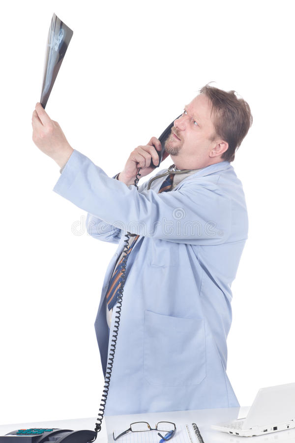 Calling Doctor Peering At X-ray Slide Royalty Free Stock Photo