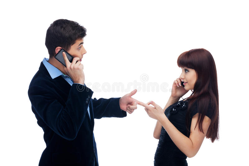 Calling me?. Man and women asking if they are calling each other royalty free stock image