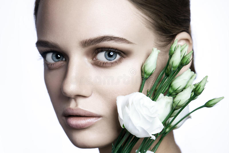 Calm Beauty Fashion Model Woman face. Portrait with white Rose flower. royalty free stock image