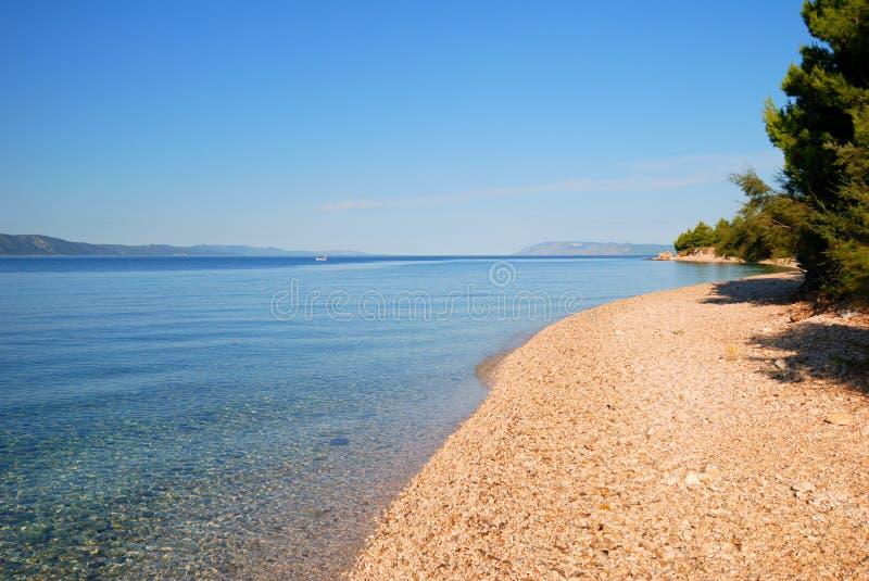 Calm Blue Sea and empty beach in Croatia. Calm Blue Sea and empty beach in the morning in Croatia royalty free stock photo